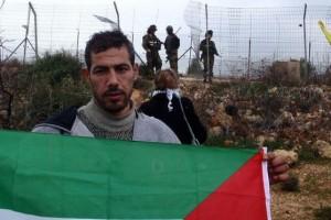 Ashraf Abu Rahmah během demonstrace v Bil'inu