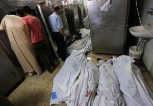 The bodies of Palestinians lie on the ground of the morgue of the al-Shifa hospital